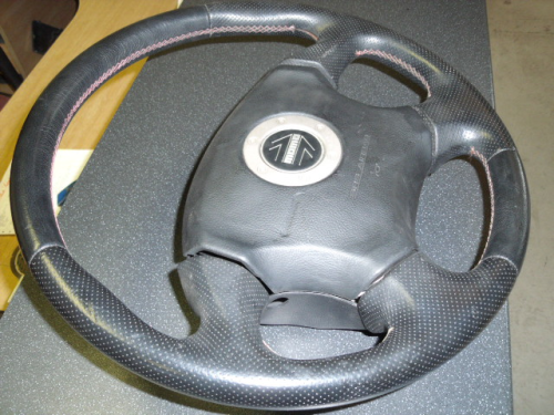 Steering wheel with airbag